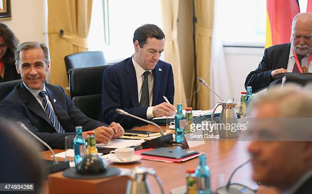 British Chancellor of the Exchequer George Osborne and Governor of the Bank of England Mark Carney attend a working session during a meeting of...