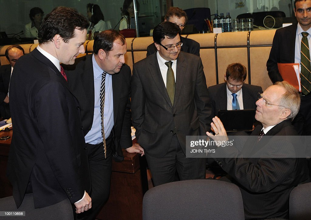 British Chancellor of the Exchequer George Osborne, Austrian Finance Minister Josef Proell, and undentified delegate, speak with German Finance Minister Wolfgang Schaeuble (R) before a Economy Task Force meeting at the EU headquarters in Brussels on May 21, 2010. European ministers headed for landmark talks on curbing overspending Friday amid global turmoil over the eurozone debt crisis and signs of damage to economic recovery.
