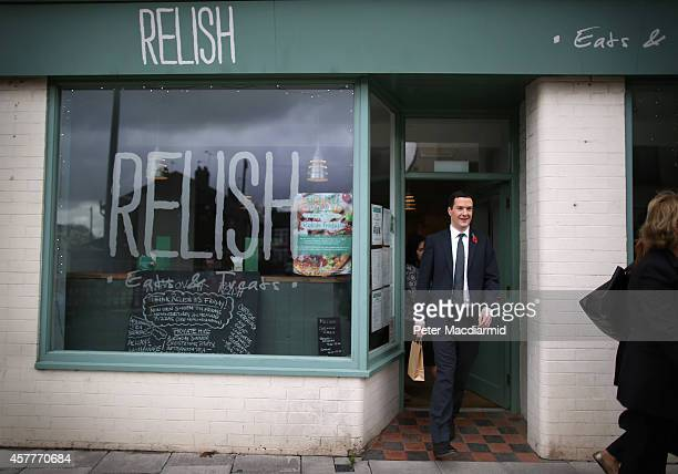 British Chancellor of the Exchequer George Osborne leaves the Relish cafe after meeting with local people on October 24 2014 in Beeston England The...