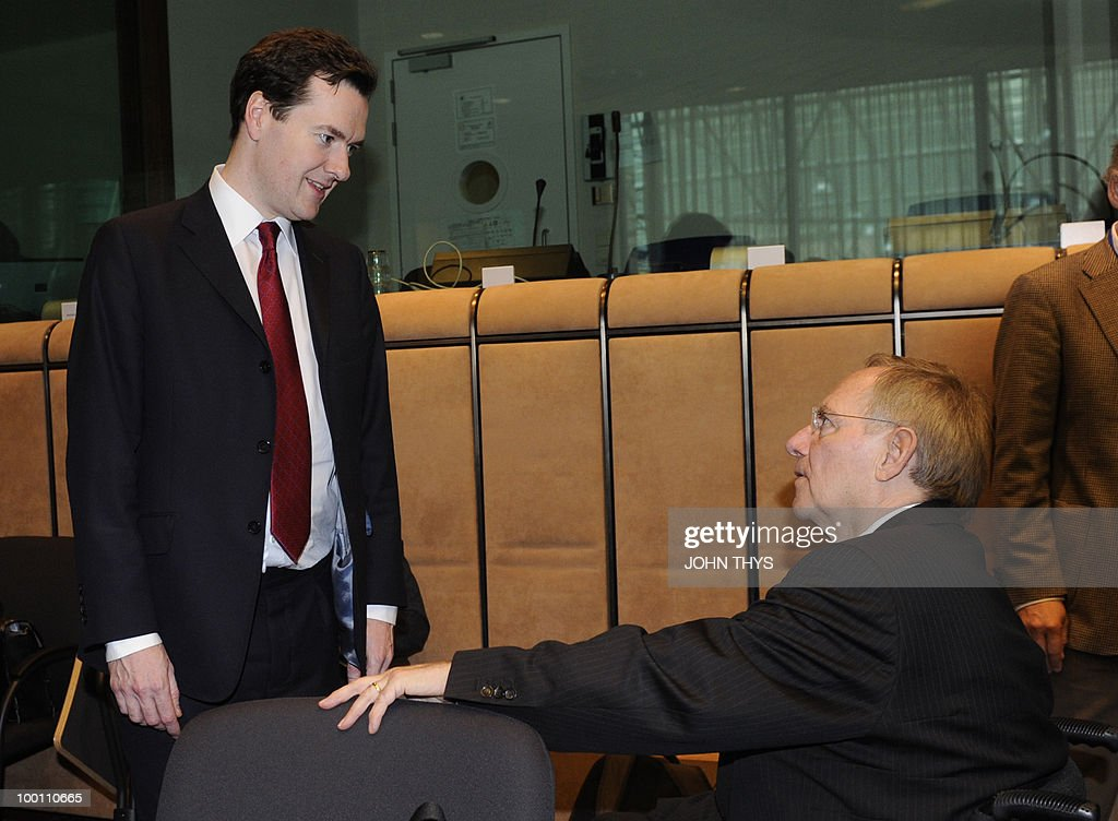 British Chancellor of the Exchequer, George Osborne (L) speaks with German Finance Minister Wolfgang Schaeuble (R) before a Economy Task Force meeting at the EU headquarters in Brussels on May 21, 2010.