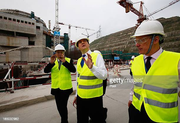 British Chancellor of the Exchequer George Osborne talks with Guo Liming of Taishan Nuclear Power Joint Venture Co Ltd and EDF Energy CEO Vincent de...