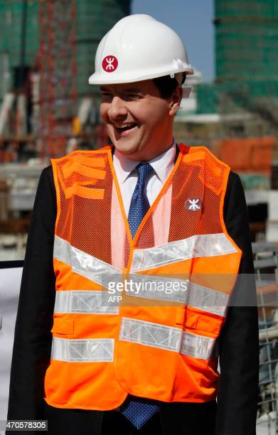 British Chancellor of the Exchequer George Osborne visits the construction site of the terminus for an express rail link which connects mainland...