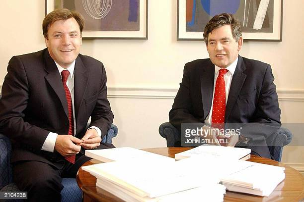 British Chancellor of the Exchequer Gordon Brown poses with Ed Balls the Chief Economic advisor with the euro report laid on the table at the...
