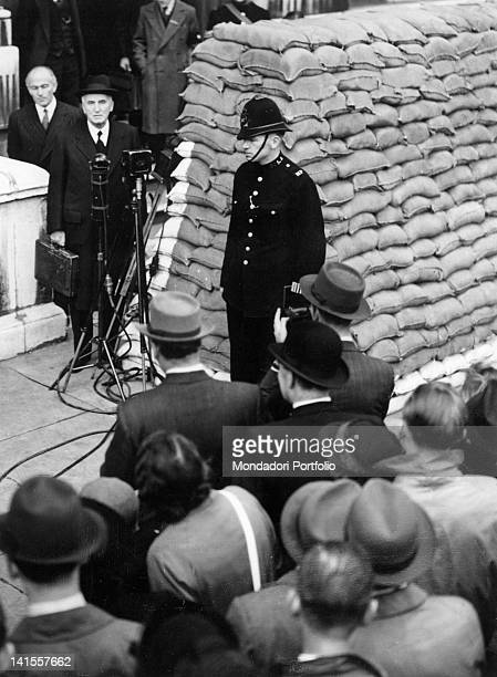 British Chancellor of the Exchequer John Simon speaking to the crowd outside the HM Treasury London September 1939