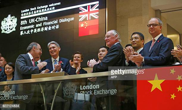 British Chancellor of the Exchequer Philip Hammond Bank of China chairman Tian Guoli and London Stock Exchange Group CEO Xavier Rolet react after...