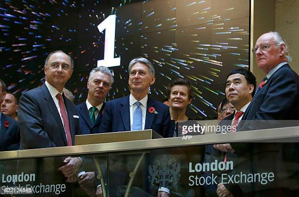 British Chancellor of the Exchequer Philip Hammond Bank of China chairman Tian Guoli and London Stock Exchange Group CEO Xavier Rolet open the...