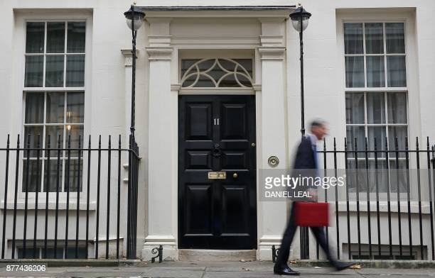 British Chancellor of the Exchequer Philip Hammond carries the Budget Box as he leaves 11 Downing Street in London on November 22 before presenting...