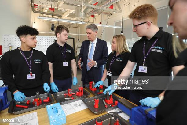 British Chancellor of the Exchequer Philip Hammond chats to staff and students at the Advanced Engineering Centre at Dudley College during a visit to...