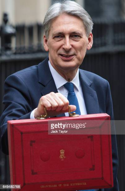 British Chancellor of the Exchequer Philip Hammond holds the budget box outside 11 Downing Street on March 8 2017 in London England Today's Budget...