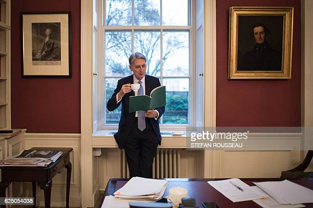 British Chancellor of the Exchequer Philip Hammond is pictured looking at his Autumn Statement in his office at 11 Downing Street in central London...