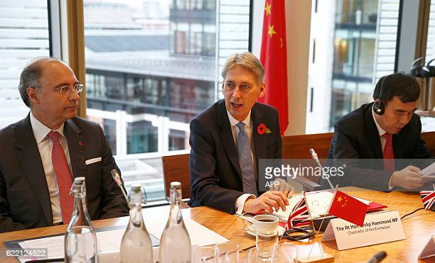 British Chancellor of the Exchequer Philip Hammond London Stock Exchange Group CEO Xavier Rolet and Bank of China chairman Tian Guoli attend a round...