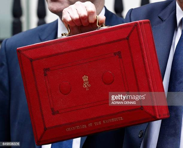 British Chancellor of the Exchequer Philip Hammond poses with the Budget Box as he leaves 11 Downing Street in London on March 8 before presenting...