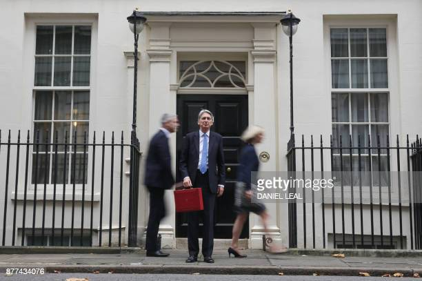 British Chancellor of the Exchequer Philip Hammond waits for his ministerial team to depart before posing with the Budget Box as he leaves 11 Downing...