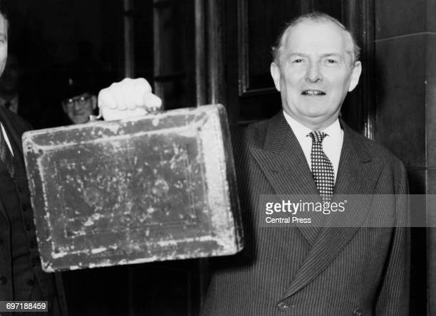 British Chancellor of the Exchequer Selwyn Lloyd holds up the red despatch box as he leaves the Treasury to present his first budget at the House of...