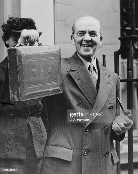 British Chancellor of the Exchequer Sir Stafford Cripps holds up his dispatch box before leaving 11 Downing Street to give his budget speech to the...