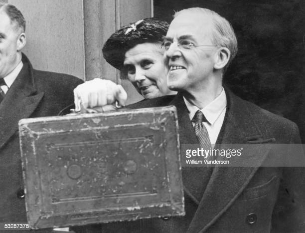 British Chancellor of the Exchequer Sir Stafford Cripps leaves the Treasury with the battered budget box on his way to the House of Commons 18th...
