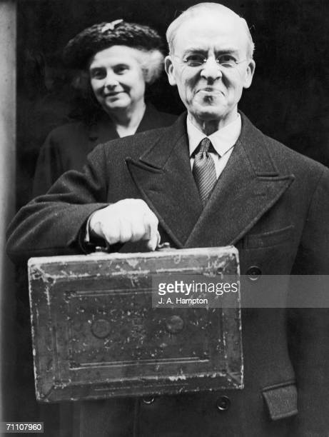 British Chancellor of the Exchequer Sir Stafford Cripps leaving number 11 Downing Street with Lady Cripps on a budget day circa 1949