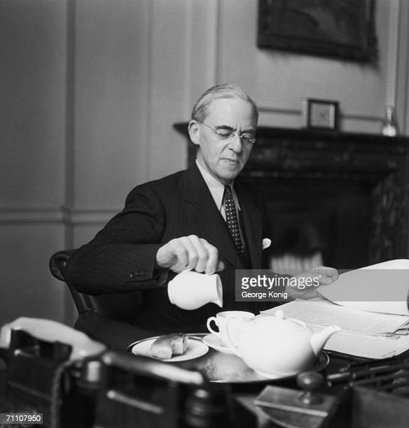 British Chancellor of the Exchequer Sir Stafford Cripps pours a cup of tea in his office 16th February 1949