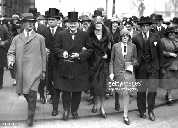 British Chancellor of the Exchequer Winston Churchill his wife Clementine their daughter Sarah and son Randolph on the way to the House of Commons on...