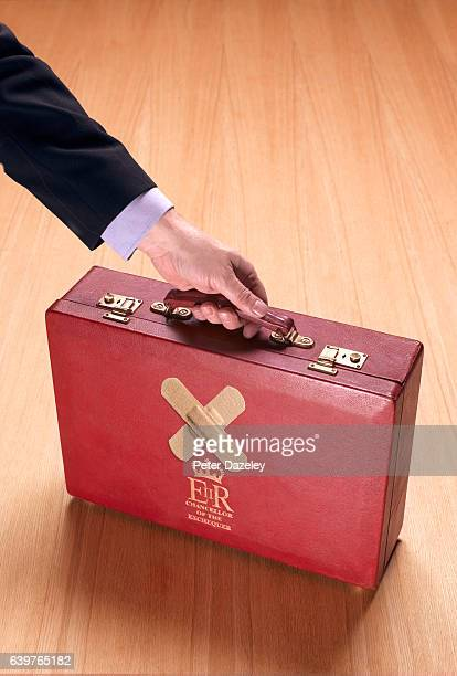 British chancellor of the exchequer's red briefcase on wooden background on January 18 2017 in London
