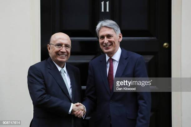 British Chancellor Philip Hammond greets Brazil's Finance Minister Henrique Meirelles at 11 Downing Street on January 22 2018 in London England