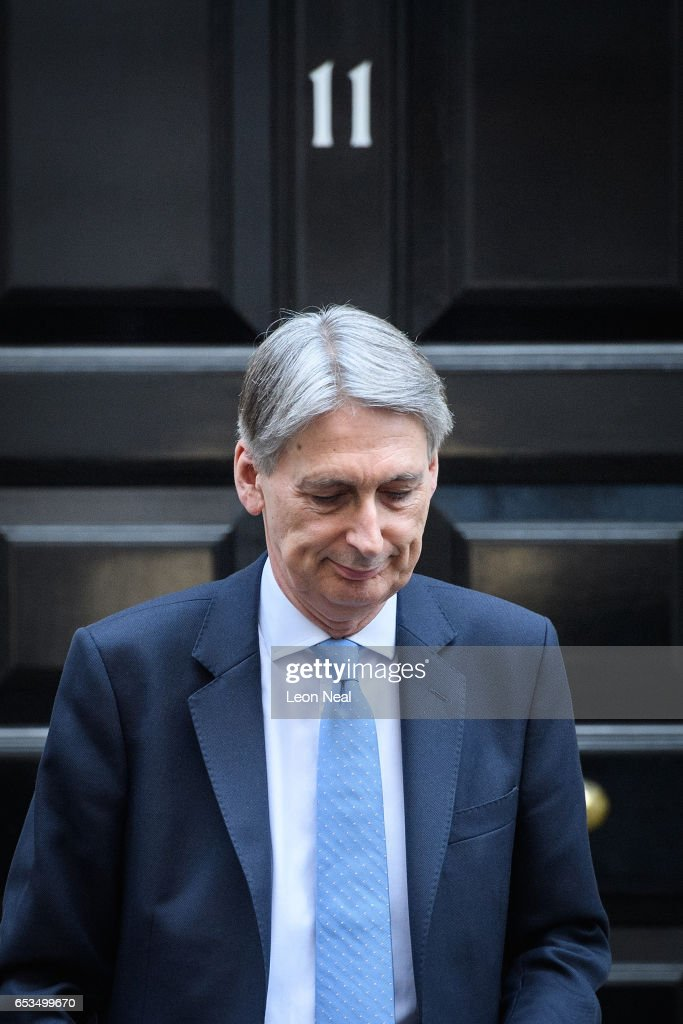 British Chancellor Philip Hammond leaves number 11, Downing Street as he makes his way to the House of Commons on March 15, 2017 in London, England. The Chancellor has announced that his controversial proposed rise in National Insurance contributions for the self-employed is to be scrapped.