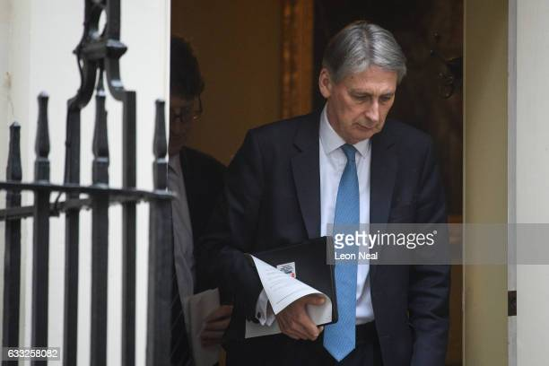 British Chancellor Phillip Hammond leaves number 11 for the weekly PMQ session in the House of Commons at Downing Street on February 1 2017 in London...