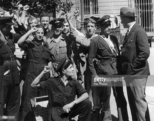 British Charge d'affairs in Madrid Sir George OgilvieForbes meets members of a republican militia group in the first months of the Spanish Civil War...