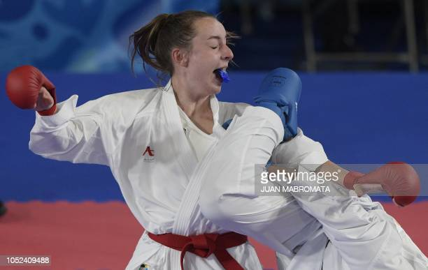 British Charlotte Hope and French Assia Oukhattou compete in the Women's Kumite 59 kg qualifying bout during the Youth Olympic Games in Buenos Aires...
