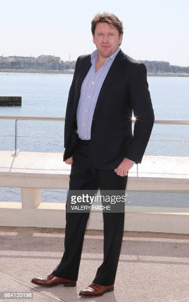 British chef James Martin who stars in the series ''James Martin's French Adventure' poses during a photocall as part of the MIPTV event on April 3...