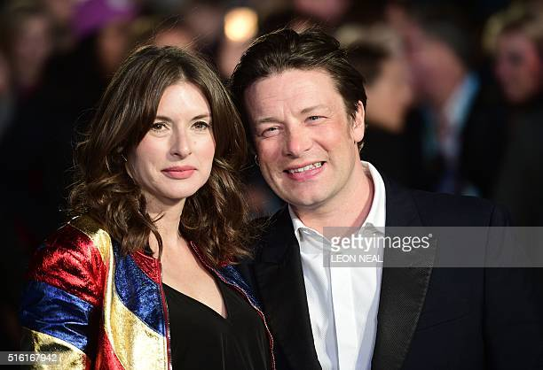 British chef Jamie Oliver and his wife Juliette pose for a photograph as they arrive for the European premiere of Eddie The Eagle in London on March...