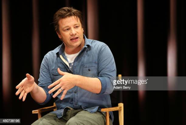 British Chef Jamie Oliver speaks at the Apple store on November 20 2013 in Berlin Germany Oliver was in Germany to talk about his Food Revolution...