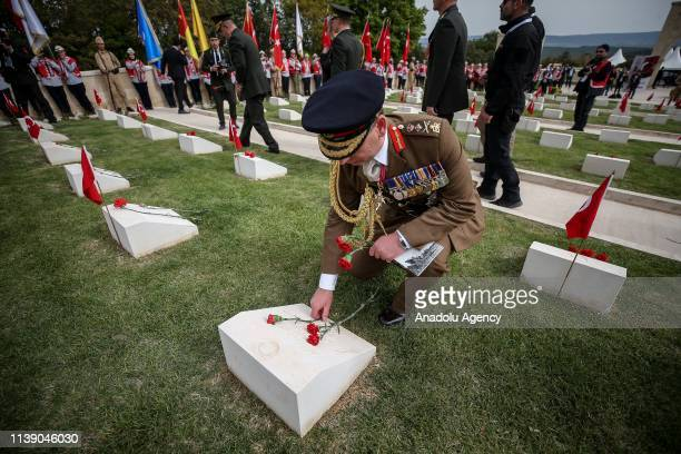 British Chief of the General Staff Mark CarletonSmith lays carnation on grave stone during commemoration ceremony at 57th Regiment Cemetery on the...