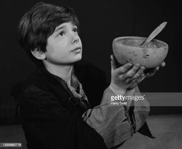 British child actor Bruce Prochnik presents his bowl and asks for more during the filming of the BBC adaptation of 'Oliver Twist' in London, England,...