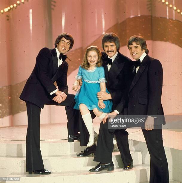 British child singer Lena Zavaroni, on stage with Irish band The Bachelors, February 1975.