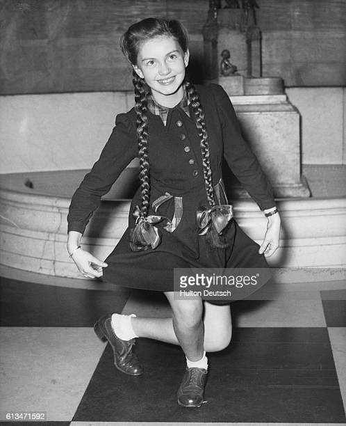 British child star Janette Scott rehearsing her courtsey at the Empire Theatre in London where she will tonight present a bouquet of flowers to the...