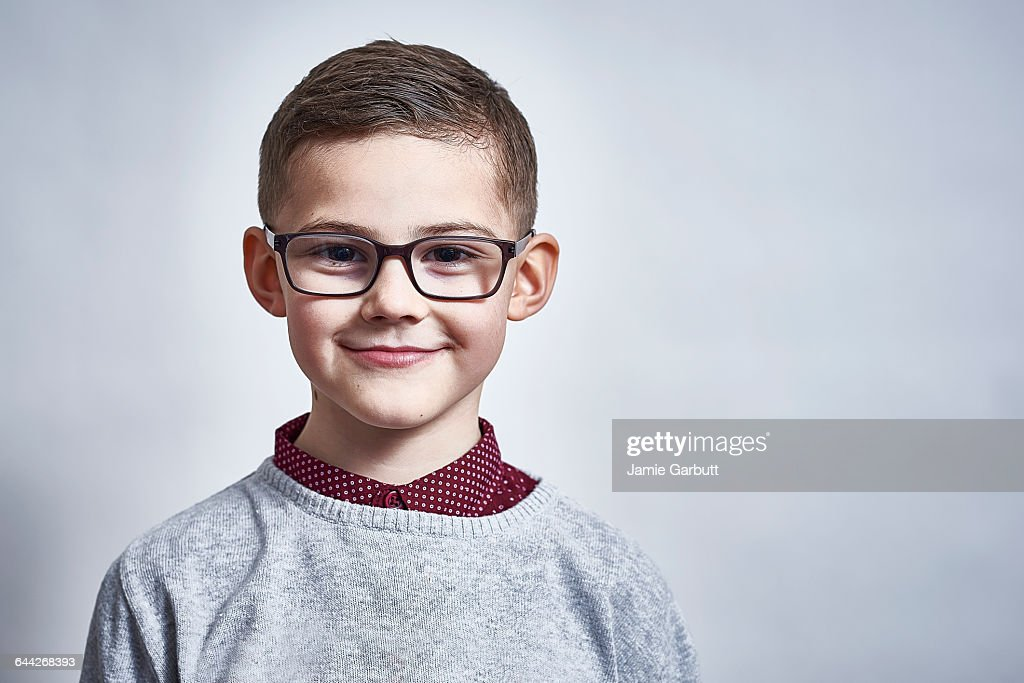 A British child stood smiling proudly : Stock-Foto