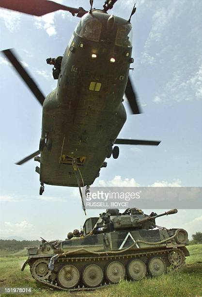 A British Chinook from the joint helicopter support unit helicopter picks up a scimitar combat vehicle during a training exercise 09 June 1999 The...