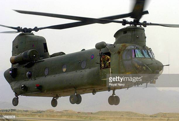 British Chinook helicopter, seen in this file photo, takes off April 13, 2002 from Bagram air base, Afghanistan, to deliver Royal Marines into the...