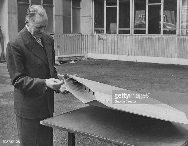 British civil engineer Gilbert Roberts one of the design consultants for the new Severn Bridge inspecting a model of the hollow box which will be...