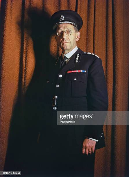 British civil servant Harold Richard Scott , recently appointed Commissioner of the Metropolitan Police, posed in his police uniform in London on...