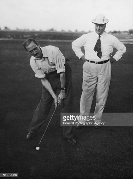 British colonial administrator the Hon Sir Bede Edmund Hugh Clifford on the golf course in Nassau Bahamas with Frank C Munson president of Munson...