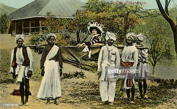 British colonial lady in Indian palanquin flanked by attendants and servants Colorized photograph from early 20th century Caption reads 'Indian...