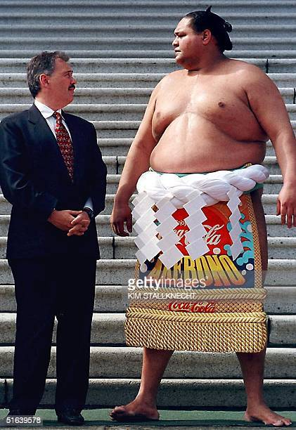 British Columbia's Premier Glen Clark chats with YokozunaAkebono following the dohyoiri ceremony performed in front of the parliament buildings 05...