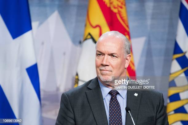 British Columbia's premier John Horgan looks on as prime ministers of the Canadian provinces gather during a meeting set-up by Canada prime minister...