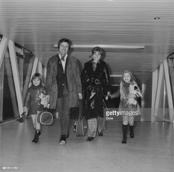 British comedian and broadcaster Des O'Connor with his wife Gillian Vaughan and daughters Tracy and Samantha at Heathrow Airport UK 11th January 1971