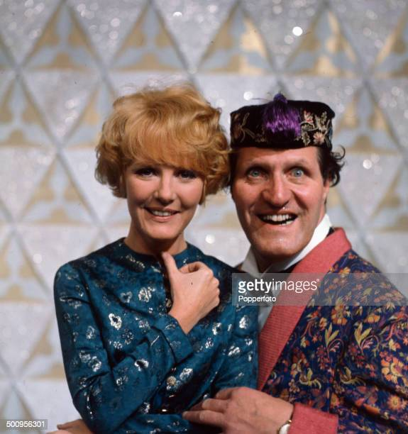 British comedian and magician Tommy Cooper pictured with singer Petula Clark on the set of the television series 'Cooperama' in 1966