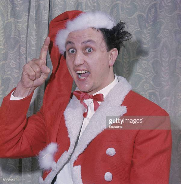 British comedian and television star Ken Dodd in a Santa Claus costume circa 1959
