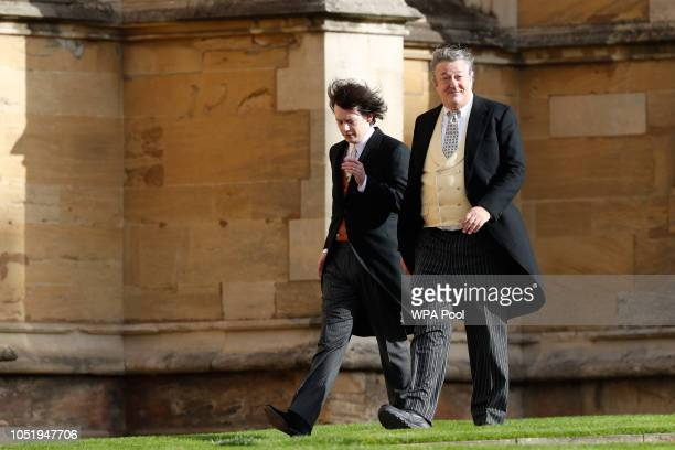 British comedian and writer Stephen Fry arrives with his husband comedian Elliott Spencer ahead of the wedding of Princess Eugenie of York and Mr...
