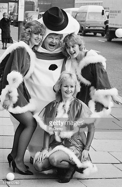 British comedian Benny Hill poses in a Christmas costume 16th December 1983